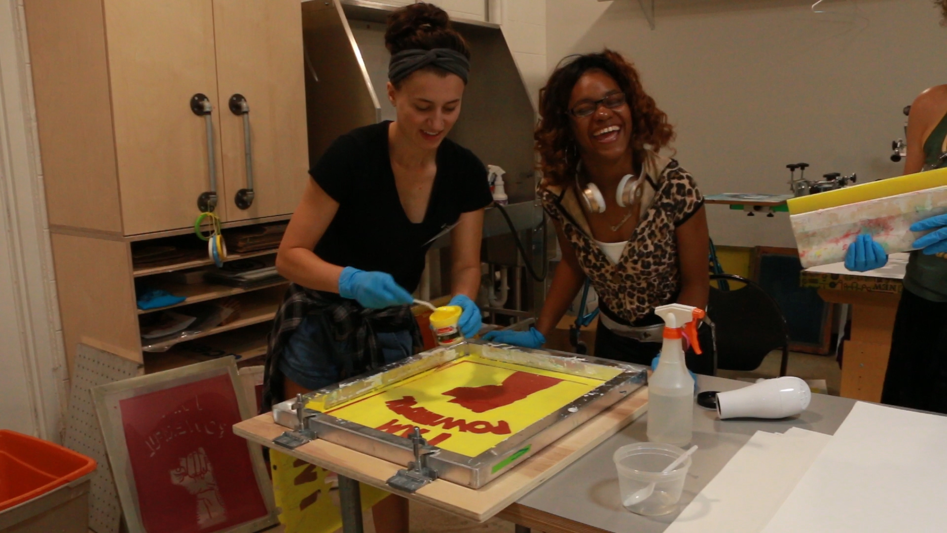 Cassandra and Stella creating a poster print of I Am Powerful
